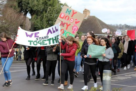 Redmaids school girls marching past plaques